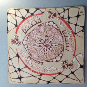 Tile I did on the plane, and left as a Random Act of Zentangle for some unsuspecting person.